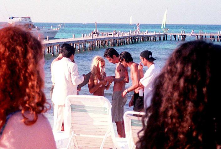 <p>Pamela Anderson and Tommy Lee getting married on the beach in Cancun in 1995.</p>