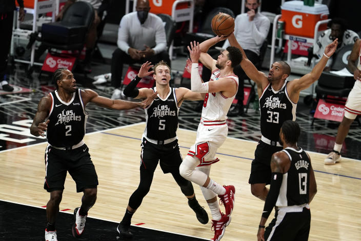 Chicago Bulls guard Zach LaVine, third from right, shoots against the Los Angeles Clippers during the first half of an NBA basketball game Sunday, Jan. 10, 2021, in Los Angeles. (AP Photo/Marcio Jose Sanchez)