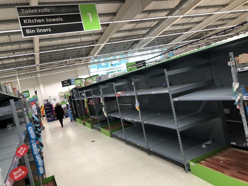 A view of empty shelves as toilet roll and kitchen roll are almost sold out in an Asda supermarket in Bearsden, East Dunbartonshire. UK shoppers are stockpiling toilet paper, pasta, hand sanitiser and tinned foods as fears grow over the spread of the coronavirus.