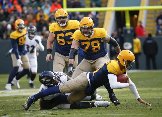 Green Bay Packers quarterback Brett Hundley is sacked by Baltimore Ravens' Terrell Suggs during a 23-0 Ravens win. (AP)