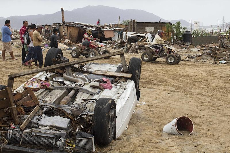 Destroyed cars and debris caused heavy rains following the passage of tropical storm Lidia in Los Cabos, Baja California, Mexico on September 1, 2017