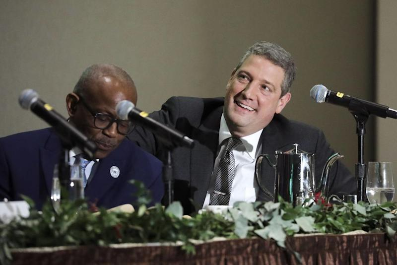 At right, Democratic presidential candidate U.S. Rep Tim Ryan (D-OH) waits to speak at the National Action Network's annual convention, April 5, 2019 in New York City. | Drew Angerer Getty Images
