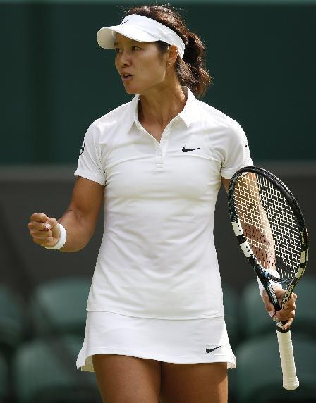 Li Na of China celebrates during her first round match against Paula Kania of Poland at the All England Lawn Tennis Championships in Wimbledon, London, Monday, June 23, 2014. (AP Photo/Pavel Golovkin)