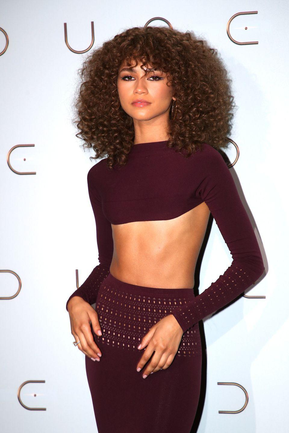 <p>Zendaya swapped her slicked back wet look hair from her previous red carpet appearance for a full head of luscious curls including a fringe. The Dune actor completed her curls with two tone winged eyeliner and her signature statement brows.</p>