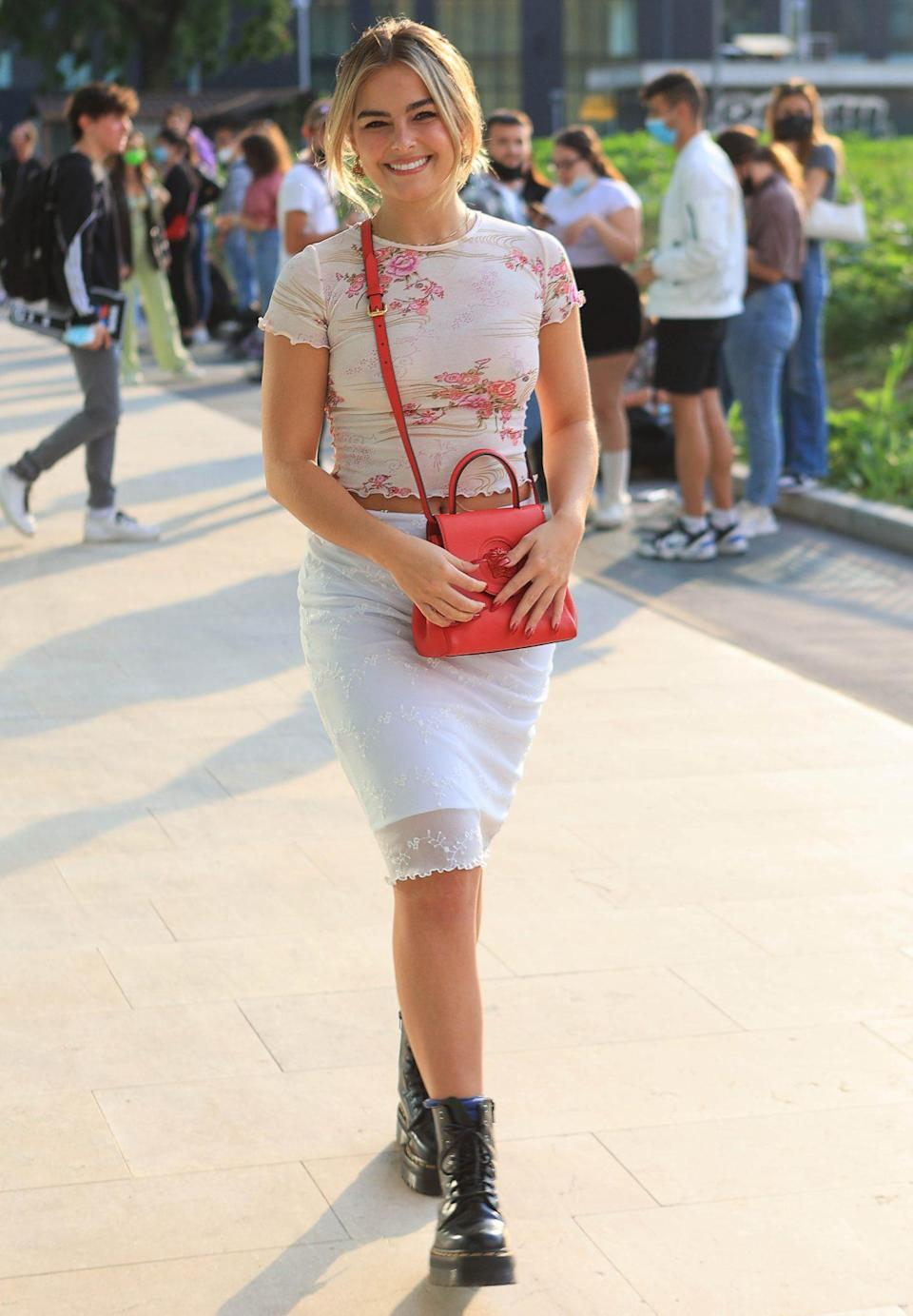 <p>Addison Rae falls for florals on Sept. 23 while arriving to a show at Milan Fashion Week in Italy.</p>