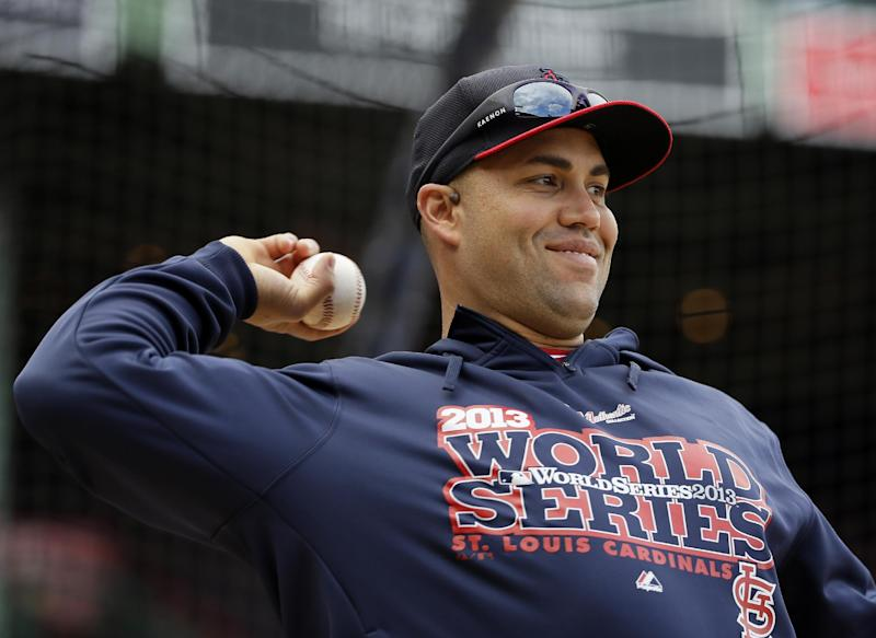 St. Louis Cardinals' Carlos Beltran throws during batting practice for Game 1 of baseball's World Series against the Boston Red Sox Tuesday, Oct. 22, 2013, in Boston. (AP Photo/Matt Slocum)