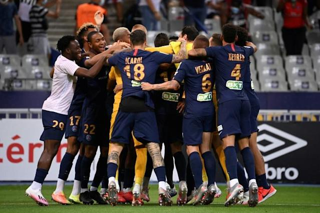 Paris Saint-Germain players celebrate after beating Lyon on penalties in the French League Cup final (AFP Photo/FRANCK FIFE)