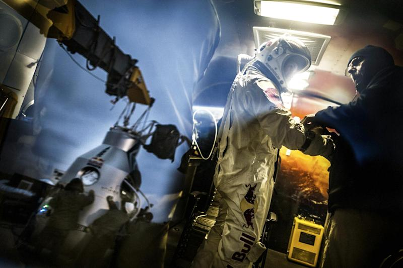In a photo provided by Red Bull, pilot Felix Baumgartner of Austria, stands in his trailer during the preparation for the final manned flight of Red Bull Stratos in Roswell, N.M. on Saturday, Oct. 6, 2012. Red Bull Stratos announced Friday that the jump by extreme athlete Baumgartner have been moved from Monday to Tuesday, Oct. 9, due to a cold front with gusty winds. The jump can only be made if winds on the ground are under 2 mph for the initial launch a balloon carrying Baumgartner. (AP Photo/Red Bull, Joerg Mitter)
