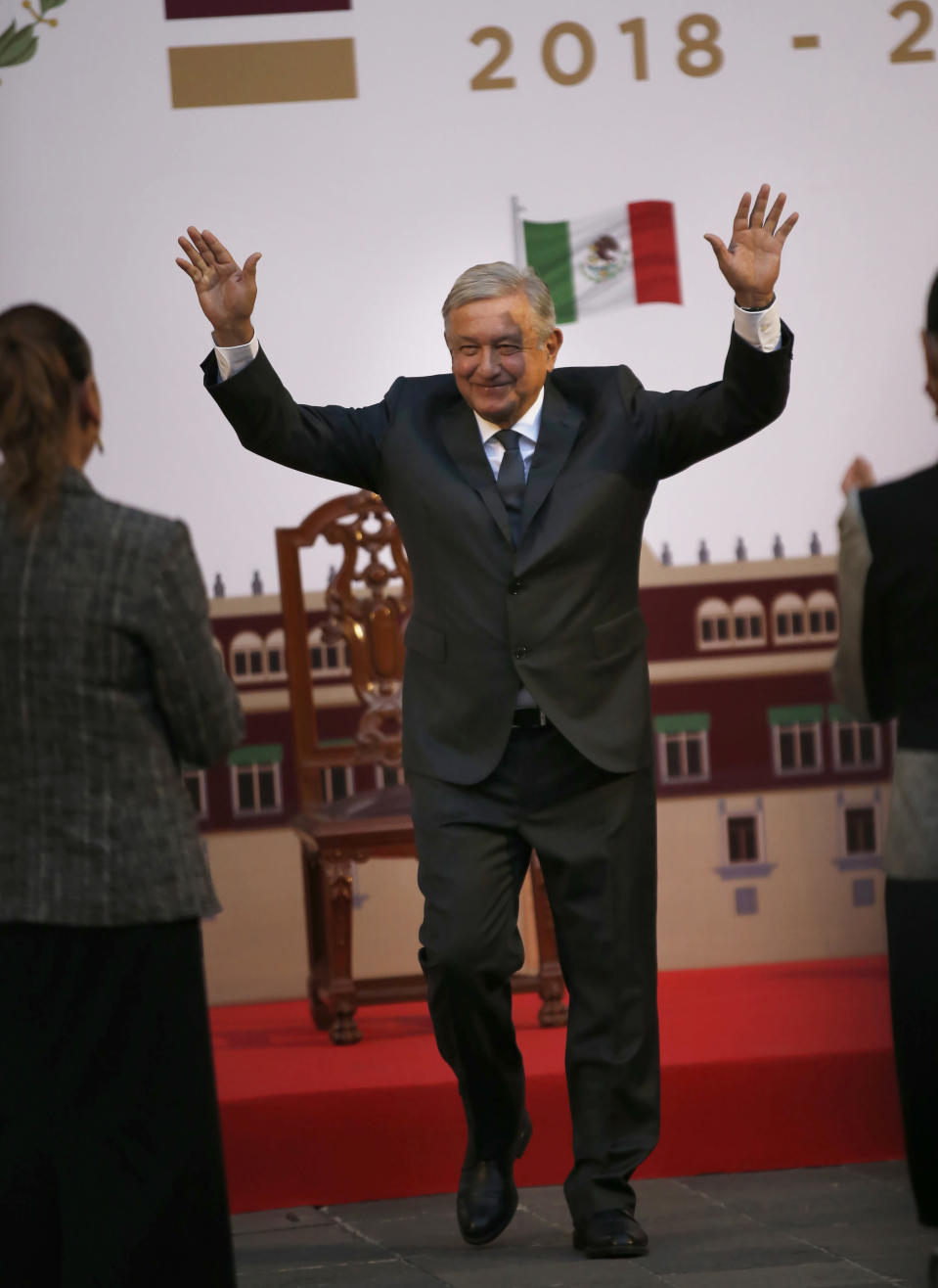 Mexican President Andres Manuel Lopez Obrador walks toward first lady Beatriz Gutierrez at the end of a ceremony to mark his second anniversary in office, at the National Palace in Mexico City, on Tuesday, December 1, 2020. (Photo AP/Marco Ugarte)