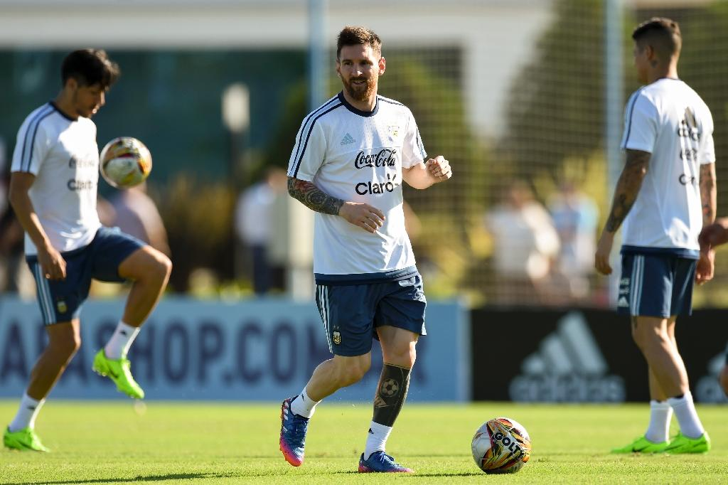 Argentina's Lionel Messi controls the ball during a training session in Ezeiza, Buenos Aires, on March 25, 2017, ahead of their Russia 2018 World Cup qualifier against Bolivia (AFP Photo/Eitan Abramovich)