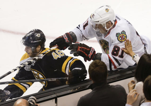 Chicago Blackhawks right wing Marian Hossa (81), of Slovakia, checks Boston Bruins center David Krejci (46), of the Czech Republic, during the second period in Game 4 of the NHL hockey Stanley Cup Finals, Wednesday, June 19, 2013, in Boston. (AP Photo/Charles Krupa)