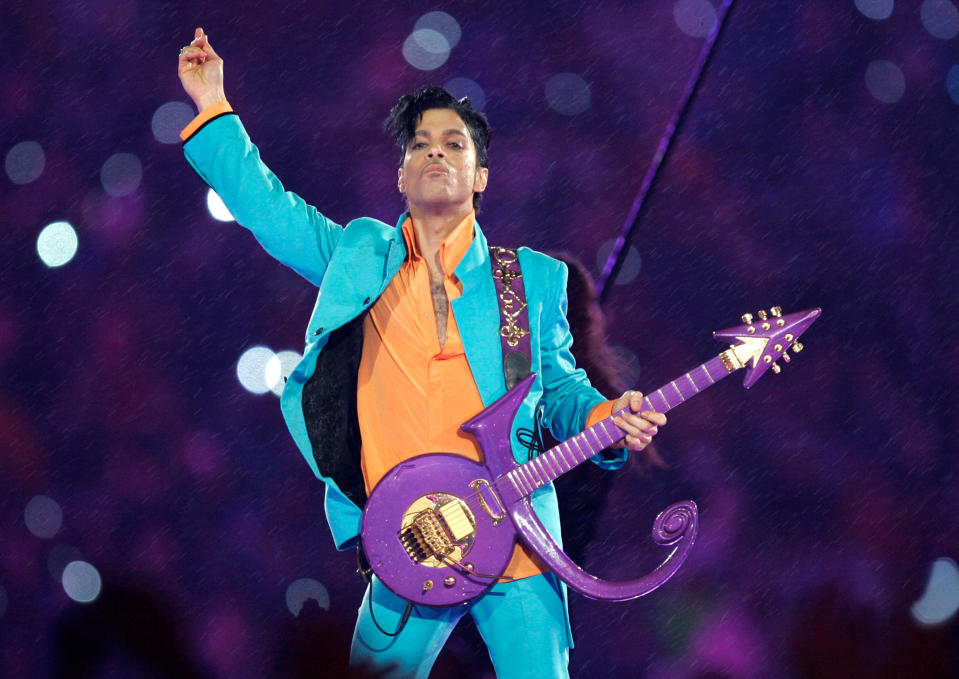 FILE - In this Feb. 4, 2007, file photo, Prince performs during the halftime show at the Super Bowl XLI football game in Miami. The saga to settle Prince's estate provides a cautionary tale about what can happen when someone dies without leaving a will, as he did when he died of an accidental opioid overdose at his Paisley Park studio April 21, 2016. (AP Photo/Chris O'Meara, File)