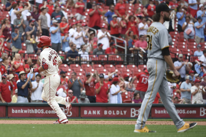 St. Louis Cardinals' Paul Goldschmidt, left, runs after hitting a home run during the fifth inning of a baseball game against the Pittsburgh Pirates, Saturday, June 26, 2021, in St. Louis. (AP Photo/Joe Puetz)