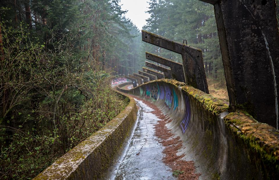*** EXCLUSIVE *** SARAJEVO, BOSNIA AND HERZEGOVINA - APRIL 2017: Bobsled track in, Sarajevo, Bosnia and Herzegovina, April 2017.   SEEMINGLY forgotten by time, these powerful images show all thats left of Sarajevo's 1984 Winter Olympic venue. Once regarded as a great achievement for the small European city, in time it would be the setting for one of the bloodiest civil wars in the 20th century. The 1984 Winter Olympics was the first ever winter olympics hosted by a communist state and was seen at the time as a major coup for socialist Yugoslavia. Photographer Ioanna Sakellaraki, 27, visited the now abandoned venue in April 2017  PHOTOGRAPH BY Ioanna Sakellaraki / Barcroft Images  London-T:+44 207 033 1031 E:hello@barcroftmedia.com - New York-T:+1 212 796 2458 E:hello@barcroftusa.com - New Delhi-T:+91 11 4053 2429 E:hello@barcroftindia.com www.barcroftmedia.com (Photo credit should read Ioanna Sakellaraki / Barcroft Im / Barcroft Media via Getty Images)