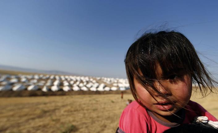 A child is seen at a camp for displaced Iraqi Shiite Turkmen in Shikhan, in Kurdistan's Dohuk province, on June 24, 2014 (AFP Photo/Karim Sahib)