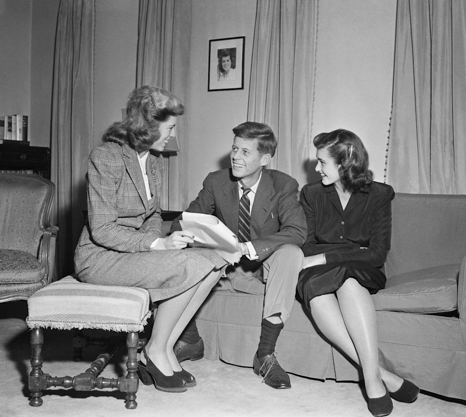 <p>Jean (right) and her sister Eunice talk with their brother John F Kennedy, who had recently been elected a Democratic representative for Massachusetts.</p>