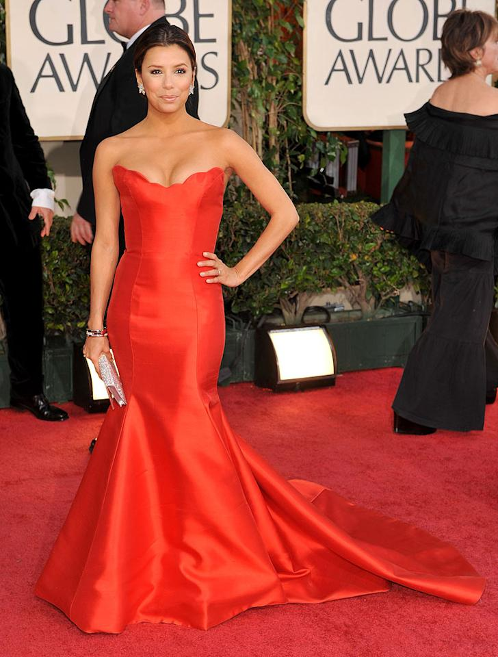 """Eva Longoria Parker (""""Desperate Housewives"""") wore a bodacious red Reem Acra frock with a scalloped bust detail. Steve Granitz/<a href=""""http://www.wireimage.com"""" target=""""new"""">WireImage.com</a> - January 11, 2009"""