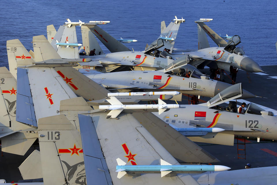J15 fighter jets on China's sole operational aircraft carrier, the Liaoning, during a drill at sea. Source: AFP