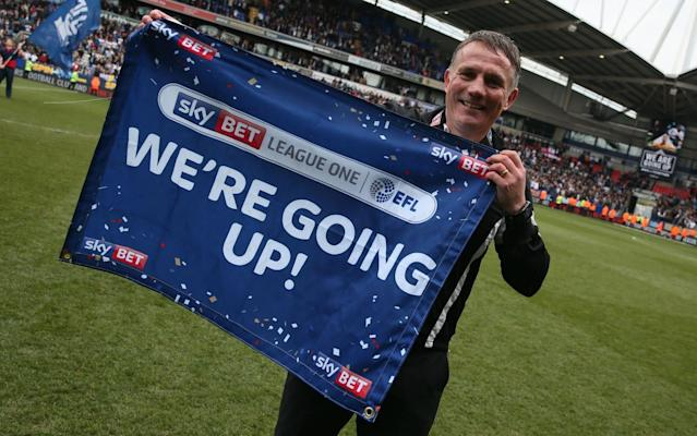Bolton Wanderers manager Phil Parkinson celebrates at the Macron Stadium - Rex Features