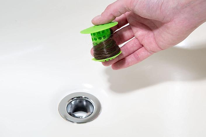 "Avoid a clogged drain — and debating who is going to clean gross hair clumps from the tub again — with this handy tool. <br /><br /><strong></strong><strong></strong><strong></strong><strong>Promising review:</strong> ""No seriously — this is amazing. I have long hair and recently had a baby. It's a wonder I still have any hair based on the clumps I see falling out on a regular basis. This means the poor tub drain is getting clogged all the time, and we're spending ridiculous amounts of time trying to clear it out. <strong>I figured if this even worked to catch half of my hair then it would be worth its salt. Holy moly. When they say it catches every hair they aren't kidding.</strong> We clean it off about twice A WEEK! And when they say it's easy to clean, they are right again. A swipe with toilet paper and the hair blob comes right off. I've already told so many people about this product because I love it so much. Fantastic!!!"" — <a href=""https://amzn.to/3gfuE7s"" target=""_blank"" rel=""noopener noreferrer"">sasamo</a><br /><br /><strong>Get it from Amazon for <a href=""https://amzn.to/3dlHwHl"" target=""_blank"" rel=""noopener noreferrer"">$12.45+</a> (available in six colors).</strong>"
