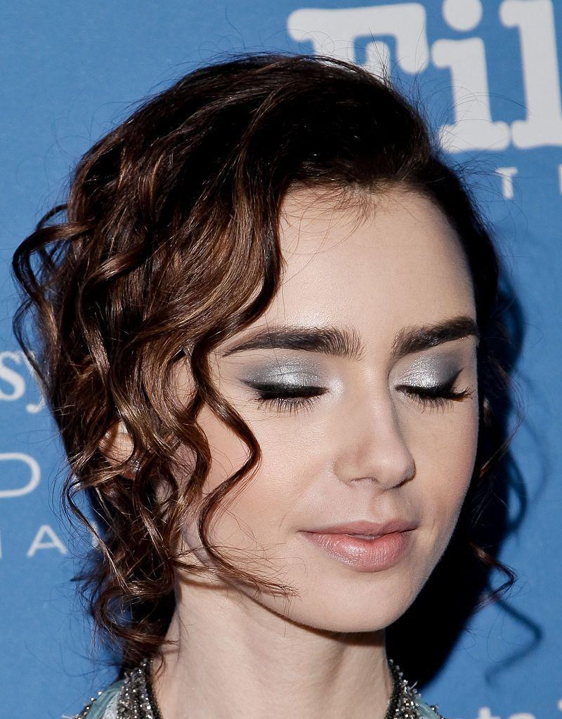 <p>A metallic silver eyeshadow like this one on Lily Collins is perfect for an evening (or even a winter) wedding. And how beautifully would it complement a blue color scheme?</p>