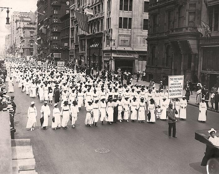 A silent march, to protest the police treatment of Black people in East St. Louis, in New York City, 1917. | Underwood Archives/Getty Images