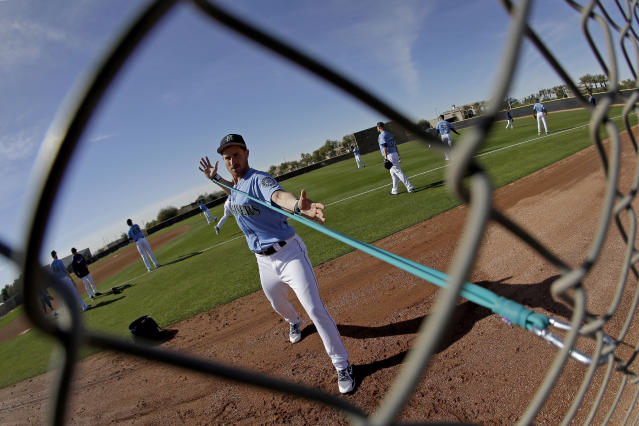 Seattle Mariners pitcher Nick Rumbelow stretches during spring training baseball practice Tuesday, Feb. 12, 2019, in Peoria, Ariz. (AP Photo/Charlie Riedel)