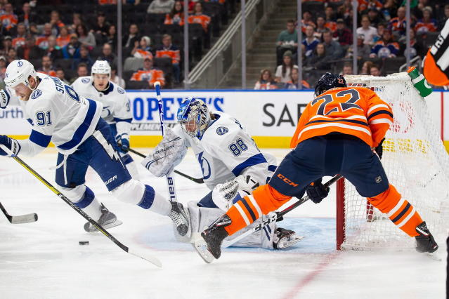 Tampa Bay Lightning goaltender Andrei Vasilevskiy (88) stops Edmonton Oilers right wing Tobias Rieder (22) during the second period of an NHL hockey game Saturday, Dec. 22, 2018, in Edmonton, Alberta. (Codie McLachlan/The Canadian Press via AP)