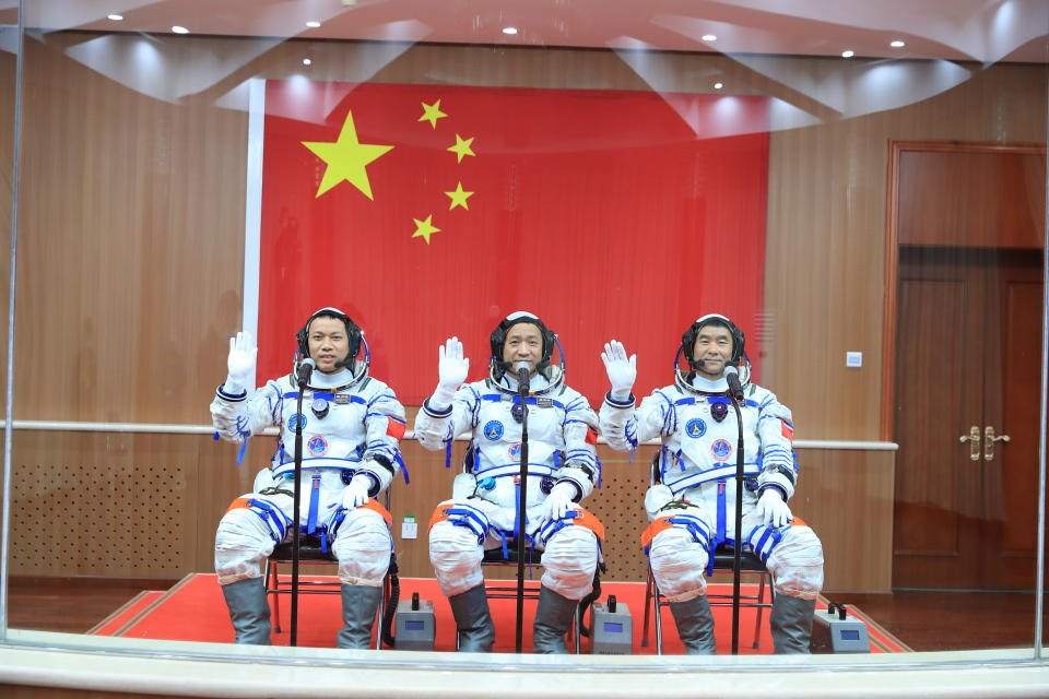 JIUQUAN, CHINA - JUNE 17: (L-R) Astronauts Tang Hongbo, Nie Haisheng and Liu Boming attend a see-off ceremony for Chinese astronauts of the Shenzhou-12 manned space mission at Jiuquan Satellite Launch Center on June 17, 2021 in Jiuquan, Gansu Province of China. China launches the Shenzhou-12 spacecraft, carried on the Long March-2F rocket, to Chinese Tiangong space station. (Photo by Yang Zhiyuan/VCG via Getty Images)