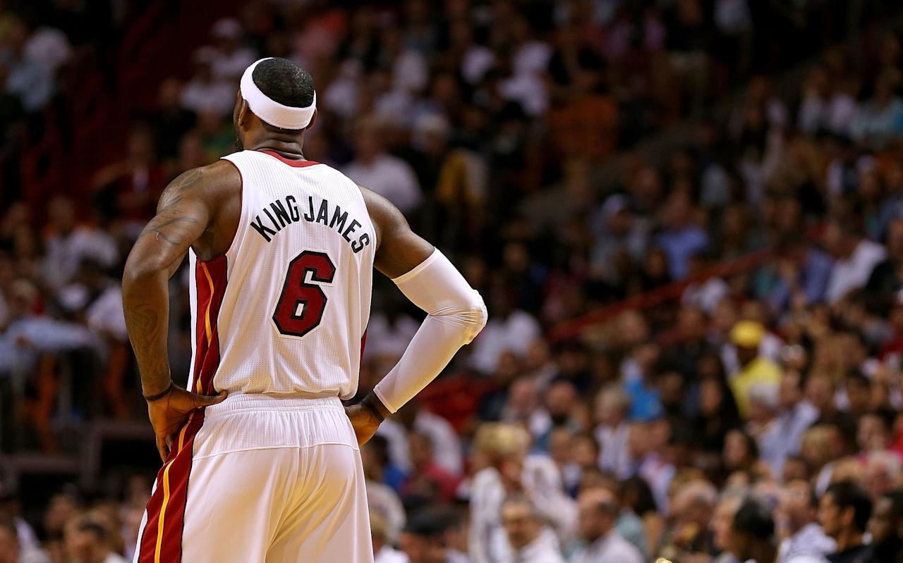 MIAMI, FL - APRIL 08: LeBron James #6 of the Miami Heat looks on during a game against the Brooklyn Nets at AmericanAirlines Arena on April 8, 2014 in Miami, Florida. NOTE TO USER: User expressly acknowledges and agrees that, by downloading and/or using this photograph, user is consenting to the terms and conditions of the Getty Images License Agreement. Mandatory copyright notice: (Photo by Mike Ehrmann/Getty Images)