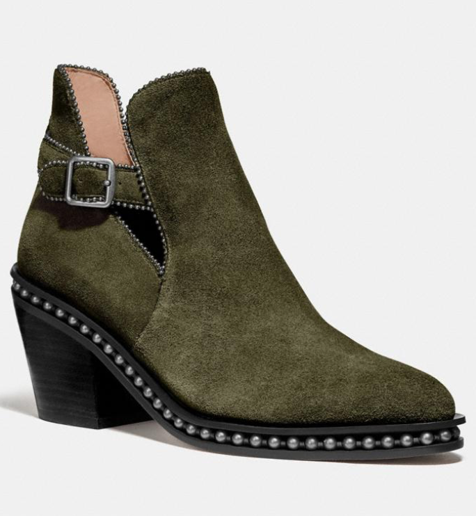 With a sensible 2.25-inch heel, you can wear these stylish boots all day long. (Photo: Coach)