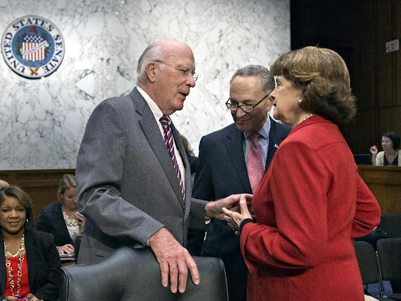 FILE - In this May 20, 2013 file photo, Senate Judiciary Committee Chairman Patrick Leahy, D-Vt., left, confers with Sen. Chuck Schumer, D-N.Y., center, and Sen. Dianne Feinstein, D-Calif., as the Senate Judiciary Committee assembled to work on a landmark immigration bill to secure the border and offer citizenship to millions, on Capitol Hill in Washington. Leading senators working on immigration legislation reached a compromise Tuesday on the details of an expanded high-tech visa program, officials said as the Senate Judiciary Committee neared completion of its work on the measure. At the same time, several officials said the White House has made it known to Leahy that it would prefer postponing a showdown over the rights of same sex spouses until a vote in the full Senate.  (AP Photo/J. Scott Applewhite, File)