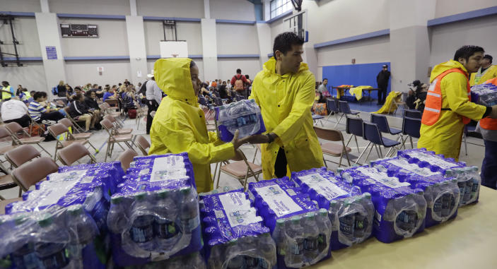 <p>Officials deliver water to an holding area for residents waiting to be evacuated, Friday, Aug. 25, 2017, in Corpus Christi, Texas. (Photo: Eric Gay/AP) </p>