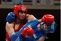 <p>Busenaz Surmeneli (red) and Ukraine's Anna Lysenko fight during their women's quarter-final boxing match.</p>