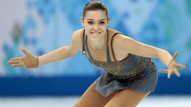 Russia's Adelina Sotnikova's won the gold medal in women's figure skating in a program that narrowly topped favorite and silver medalist Yuna Kim. Betsy McKay reports from Sochi on the News Hub. Photo: AP.