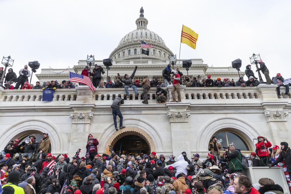 Protesters seen all over Capitol building where pro-Trump supporters riot and breached the Capitol in Washington, DC on January 6, 2021. Rioters broke windows and breached the Capitol building in an attempt to overthrow the results of the 2020 election. Police used buttons and tear gas grenades to eventually disperse the crowd. Rioters used metal bars and tear gas as well against the police. (Photo by Lev Radin/Sipa USA)