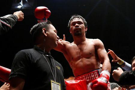 Boxing - WBA Welterweight Title Fight - Manny Pacquiao v Lucas Matthysse - Axiata Arena, Kuala Lumpur, Malaysia - July 15, 2018   Manny Pacquiao celebrates after winning the bout against Lucas Matthysse  REUTERS/Lai Seng Sin