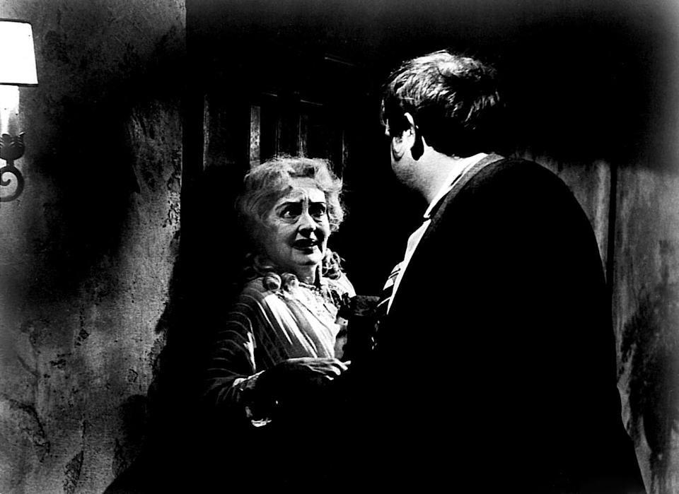 <p>Davis and Victor Buono in a scene from<em> What Ever Happened to Baby Jane? </em>Davis played the eponymous Jane, a renowned child star who faded into obscurity as she aged and was overshadowed by her younger sister Blanche (Crawford), whom she bitterly resents. </p>