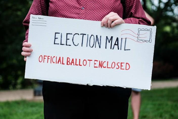 "<div class=""inline-image__title""> 1228054741 </div> <div class=""inline-image__caption""> <p>""WASHINGTON, DC - AUGUST 15: Protest material that resemble mail-in election ballots are seen as demonstrators gather on Kalorama Park to protest President Donald Trump donor and current U.S. Postmaster General Louis Dejoy on August 15, 2020 in Washington, DC. The protests are in response to a recent statement by President Trump to withhold USPS funding that would ensure that the post office would be unable handle mail-in voting ballots for the upcoming 2020 Election. (Photo by Michael A. McCoy/Getty Images)""</p> </div> <div class=""inline-image__credit""> Michael A. McCoy </div>"