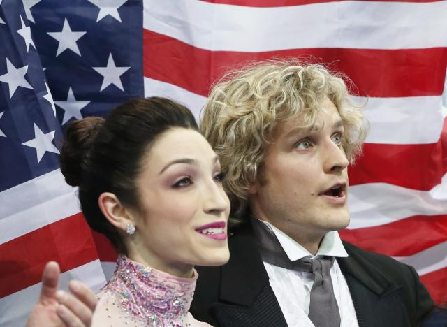 Meryl Davis (L) and Charlie White of the U.S. react at the kiss and cry after their figure skating team ice dance short dance at the Sochi 2014 Winter Olympics, February 8, 2014. REUTERS/Lucy Nicholson (RUSSIA - Tags: SPORT FIGURE SKATING OLYMPICS)