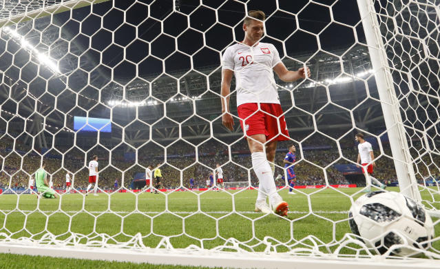 Poland's Lukasz Piszczek reacts after Colombia's Radamel Falcao scored his side' second goal during the group H match between Poland and Colombia at the 2018 soccer World Cup at the Kazan Arena in Kazan, Russia, Sunday, June 24, 2018. (AP Photo/Frank Augstein)