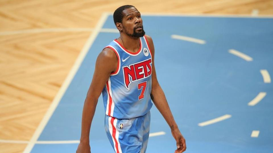 Kevin Durant looks skyward in Nets classic uniform, no opponents visible