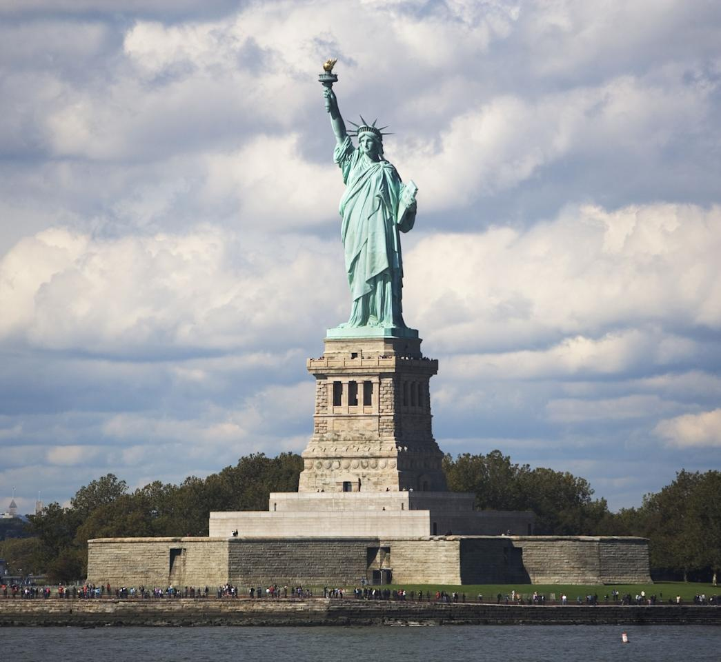 """<p>It's technically a sign of damage. The statue's infrastructure is iron, but its exterior is copper, which has turned green over time due to oxidation, reports <a rel=""""nofollow"""" href=""""http://www.telegraph.co.uk/travel/destinations/north-america/united-states/new-york/articles/Statue-of-Liberty-50-fascinating-facts/"""">The Telegraph</a>. However, that green coating protects the statue from further damage and deterioration. Originally, the statue was a <a rel=""""nofollow"""" href=""""http://www.dailymail.co.uk/news/article-2037582/The-copper-Statue-Liberty-appeared-New-York-1880s.html"""">true copper color</a>. </p>"""