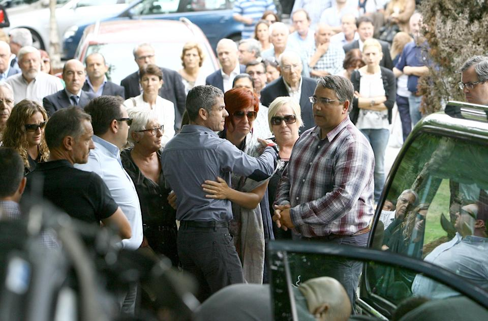 OLEIROS, SPAIN - AUGUST 17: Sandra Ortega (3R)and Pablo Gomez (R) attend the funeral for Rosalia Mera, richest Spanish woman and Amancio Ortega's ex wife and one of Zara clothes shop's founders, on August 17, 2013 in Oleiros, Spain.  (Photo by Europa Press/Europa Press via Getty Images)