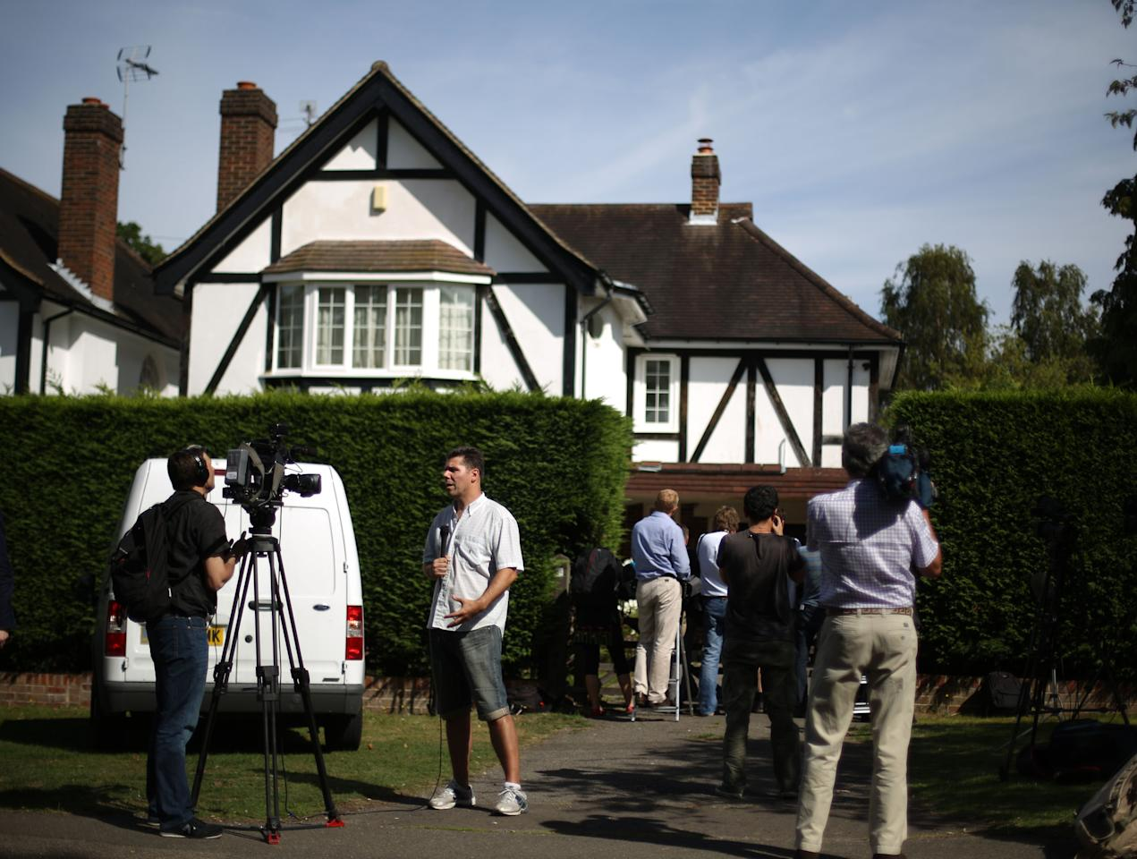 CLAYGATE, ENGLAND - SEPTEMBER 06:  Journalists gather at a house believed to be owned by a British family murdered in a shooting in the French Alps France on September 6, 2012 in Claygate, England. French police are investigating a multiple murder after the bodies of three members of a British family were found in a bullet-riddled car in the French resort of Annecy. A 4-year-old girl, who had remained hidden for hours, was also found alive after investigators eventually entered the car. Local news agencies have named the male victim as Saad al-Hilli.  (Photo by Peter Macdiarmid/Getty Images)
