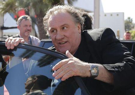 """Cast member Gerard Depardieu enters a car as he leaves after the screening of the film """"Valley of Love"""" in competition at the 68th Cannes Film Festival in Cannes"""