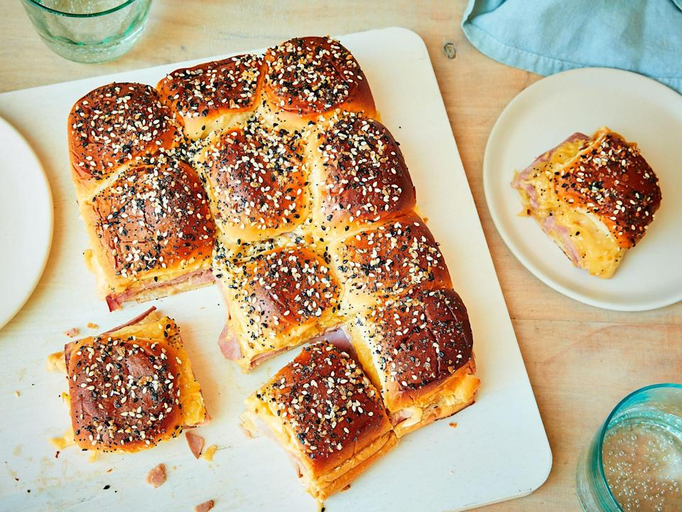 """<p><strong>Recipe: <a href=""""https://www.southernliving.com/recipes/ham-delights"""" rel=""""nofollow noopener"""" target=""""_blank"""" data-ylk=""""slk:Ham Delights"""" class=""""link rapid-noclick-resp"""">Ham Delights</a></strong></p> <p>This 13x9 recipe is a quintessential holiday appetizer if we've ever seen one, and the mini baked sandwiches almost always feature the same flavor combo of butter, poppyseeds, Dijon mustard, and Hawaiian rolls. Oh, and more butter. </p>"""