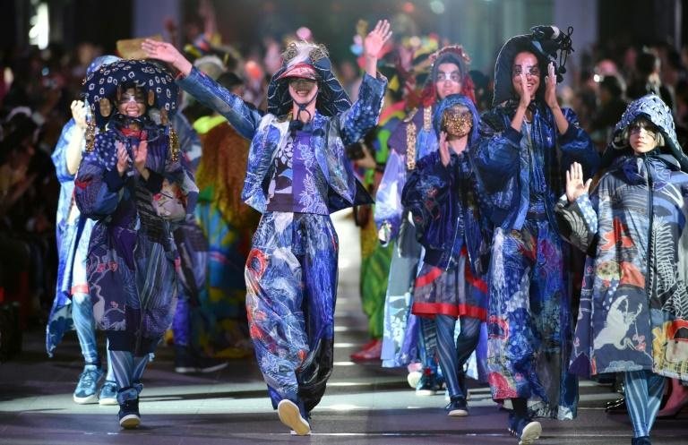 Yamamoto's exuberant clothes and personality belied a darkness he said stemmed from a difficult childhood