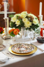 """<p>A gorgeous fall table from <a href=""""https://www.annehepfer.com/"""" rel=""""nofollow noopener"""" target=""""_blank"""" data-ylk=""""slk:Anne Hepfer"""" class=""""link rapid-noclick-resp"""">Anne Hepfer</a> features a large white floral centerpiece accompanied by smaller arrangements of orange blooms. </p>"""