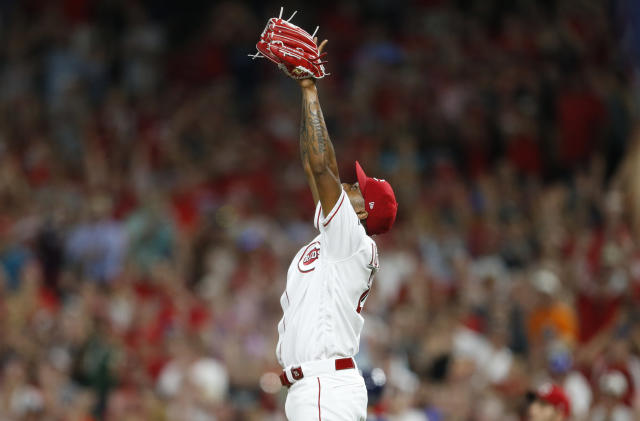 Cincinnati Reds relief pitcher Raisel Iglesias (26) celebrates the team's 3-0 win over the Milwaukee Brewers during in a baseball game, Wednesday, July 3, 2019, in Cincinnati. (AP Photo/Gary Landers)